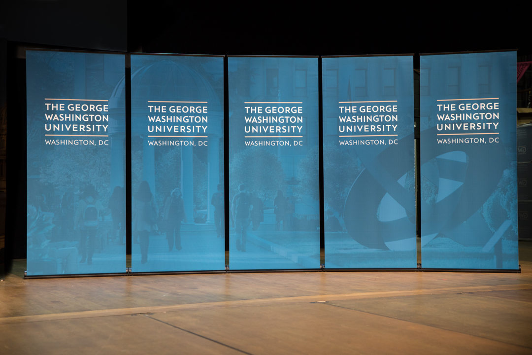 Stage display with the George Washington University Pop up banners