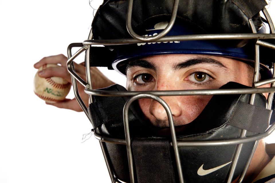 Close up shot of a baseball catcher about to throw a ball