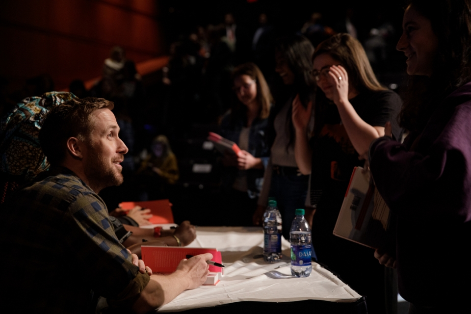 Actor Ryan Gosling signing autographs for fans