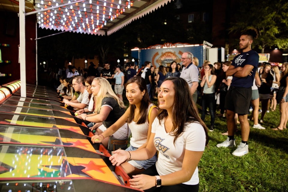 GW students playing carnival games at First Night